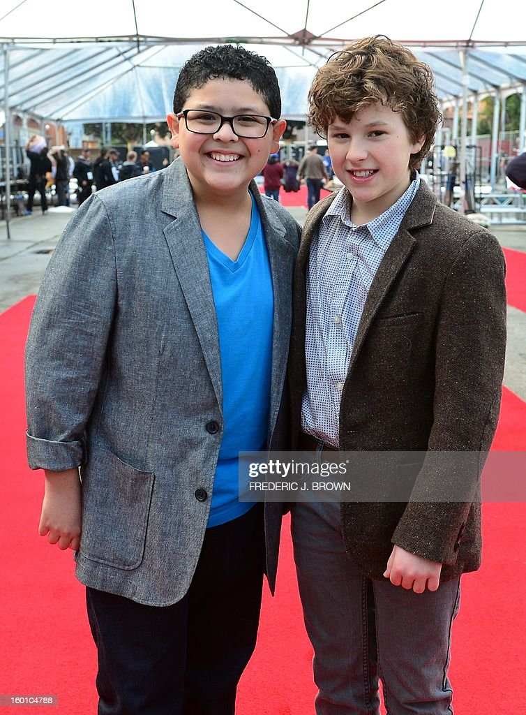 Actors Rico Rodriguez (L) and Nolan Gould (R) pose for the cameras after rolling out the red carpet in Los Angeles on January 26, 2013 during preparations ahead of the 19th Annual Screen Actors Guild (SAG) Awards on January 27. AFP PHOTO/Frederic J. BROWN
