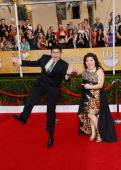 Actors Rico Rodriguez and Raini Rodriguez attend the 20th Annual Screen Actors Guild Awards at The Shrine Auditorium on January 18 2014 in Los...