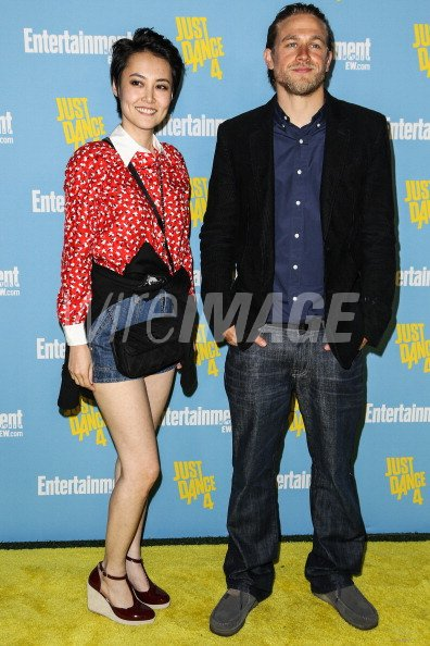 Actors Rinko Kikuchi and Charlie Hunnam arrive at ...