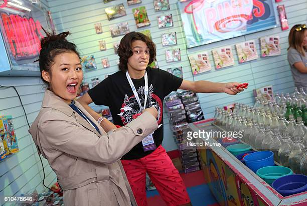 Actors Rio Mangini and Haley Tju play Ring Toss with guests during the 17th Annual Mattel Party on the Pier on September 25 2016 in Santa Monica...