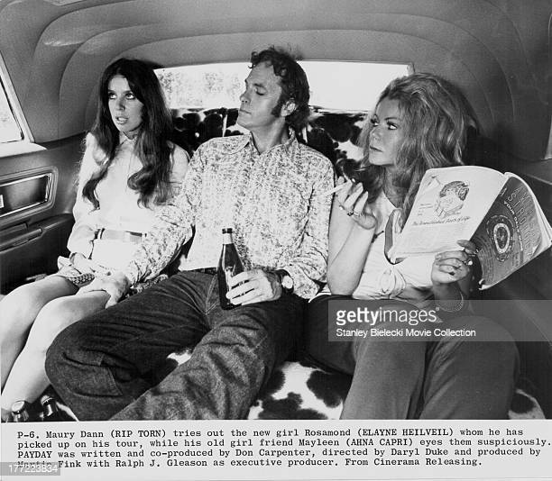 Actors Rip Torn Ahna Capri and Elayne Heilveil in a scene from the movie 'Payday' 1973