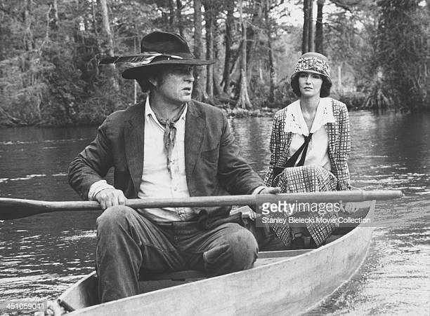 Actors Rip Torn and Mary Steenburgen in a rowing boat in a scene from the movie 'Cross Creek' 1983