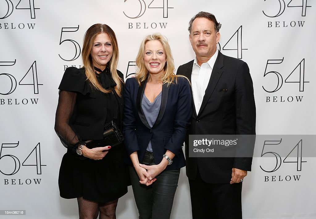 Actors <a gi-track='captionPersonalityLinkClicked' href=/galleries/search?phrase=Rita+Wilson+-+Actress&family=editorial&specificpeople=202642 ng-click='$event.stopPropagation()'>Rita Wilson</a> (L) and <a gi-track='captionPersonalityLinkClicked' href=/galleries/search?phrase=Tom+Hanks&family=editorial&specificpeople=201790 ng-click='$event.stopPropagation()'>Tom Hanks</a> (R) pose with actress/ singer Sherie Rene Scott (C) backstage prior to her performance at 54 Below on October 19, 2012 in New York City.