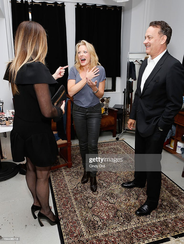 Actors <a gi-track='captionPersonalityLinkClicked' href=/galleries/search?phrase=Rita+Wilson+-+Actress&family=editorial&specificpeople=202642 ng-click='$event.stopPropagation()'>Rita Wilson</a> and <a gi-track='captionPersonalityLinkClicked' href=/galleries/search?phrase=Tom+Hanks&family=editorial&specificpeople=201790 ng-click='$event.stopPropagation()'>Tom Hanks</a> surprise actress/singer Sherie Rene Scott backstage prior to her performance at 54 Below on October 19, 2012 in New York City.