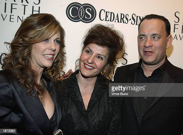 Actors Rita Wilson Nia Vardalos and Tom Hanks attend 'An Unforgettable Evening' presented by Saks Fifth Avenue to benefit CedarsSinai Research for...
