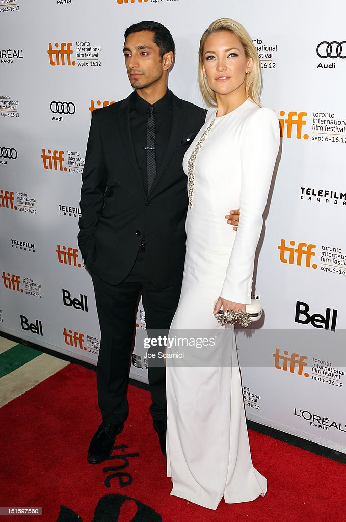 Actors Riz Ahmed (L) and <a gi-track='captionPersonalityLinkClicked' href=/galleries/search?phrase=Kate+Hudson&family=editorial&specificpeople=156407 ng-click='$event.stopPropagation()'>Kate Hudson</a> attend 'The Reluctant Fundamentalist' premiere during the 2012 Toronto International Film Festival at Roy Thomson Hall on September 8, 2012 in Toronto, Canada.