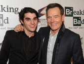 Actors RJ Mitte and Bryan Cranston arrive at the screening of 'No Half Measures Creating The Final Season Of Breaking Bad' DVD Launch at Pacific...