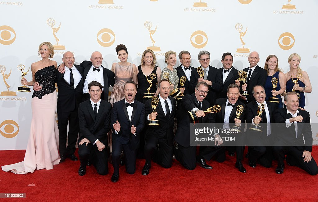 Actors <a gi-track='captionPersonalityLinkClicked' href=/galleries/search?phrase=RJ+Mitte&family=editorial&specificpeople=4542119 ng-click='$event.stopPropagation()'>RJ Mitte</a>, <a gi-track='captionPersonalityLinkClicked' href=/galleries/search?phrase=Anna+Gunn&family=editorial&specificpeople=589359 ng-click='$event.stopPropagation()'>Anna Gunn</a>, <a gi-track='captionPersonalityLinkClicked' href=/galleries/search?phrase=Dean+Norris&family=editorial&specificpeople=4195761 ng-click='$event.stopPropagation()'>Dean Norris</a>, <a gi-track='captionPersonalityLinkClicked' href=/galleries/search?phrase=Betsy+Brandt&family=editorial&specificpeople=4819893 ng-click='$event.stopPropagation()'>Betsy Brandt</a>, <a gi-track='captionPersonalityLinkClicked' href=/galleries/search?phrase=Bryan+Cranston&family=editorial&specificpeople=217768 ng-click='$event.stopPropagation()'>Bryan Cranston</a>, <a gi-track='captionPersonalityLinkClicked' href=/galleries/search?phrase=Aaron+Paul+-+Actor&family=editorial&specificpeople=693211 ng-click='$event.stopPropagation()'>Aaron Paul</a>, <a gi-track='captionPersonalityLinkClicked' href=/galleries/search?phrase=Bob+Odenkirk&family=editorial&specificpeople=2994139 ng-click='$event.stopPropagation()'>Bob Odenkirk</a> and Jonathan Banks with show creator <a gi-track='captionPersonalityLinkClicked' href=/galleries/search?phrase=Vince+Gilligan&family=editorial&specificpeople=4360133 ng-click='$event.stopPropagation()'>Vince Gilligan</a> and producers, winners of the Best Drama Series Award for 'Breaking Bad' pose in the press room during the 65th Annual Primetime Emmy Awards held at Nokia Theatre L.A. Live on September 22, 2013 in Los Angeles, California.