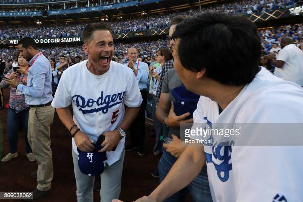 Actors Rob Lowe and Ken Jeong joke around prior to Game 1 of the 2017 World Series between the Houston Astros and the Los Angeles Dodgers at Dodger...