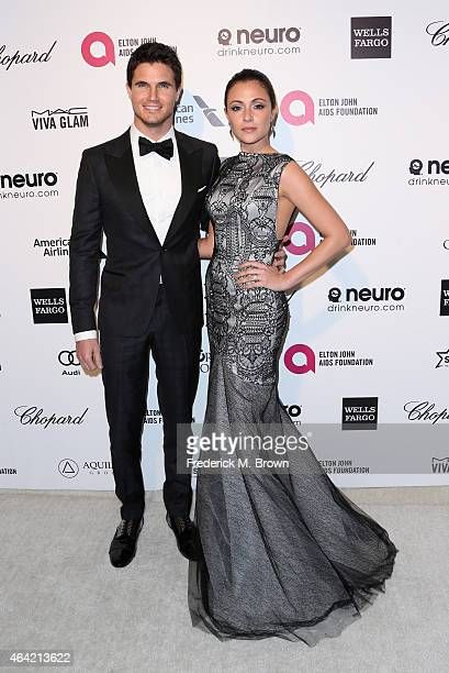 Actors Robbie Amell and Italia Ricci attend the 23rd Annual Elton John AIDS Foundation's Oscar Viewing Party on February 22 2015 in West Hollywood...