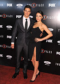 Actors Robbie Amell and Italia Ricci attend the premiere of Fox's 'The XFiles' at California Science Center on January 12 2016 in Los Angeles...