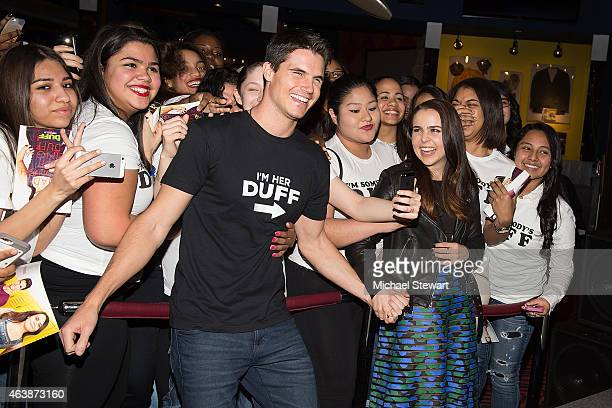 Actors Robbie Amell and Mae Whitman visit Planet Hollywood Times Square on February 19 2015 in New York City