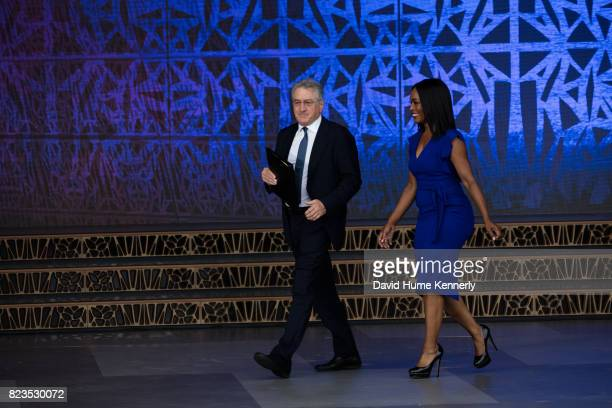 Actors Robert De Niro and Angela Bassett walk onstage at the opening of the National Museum of African American History and Culture Washington DC...