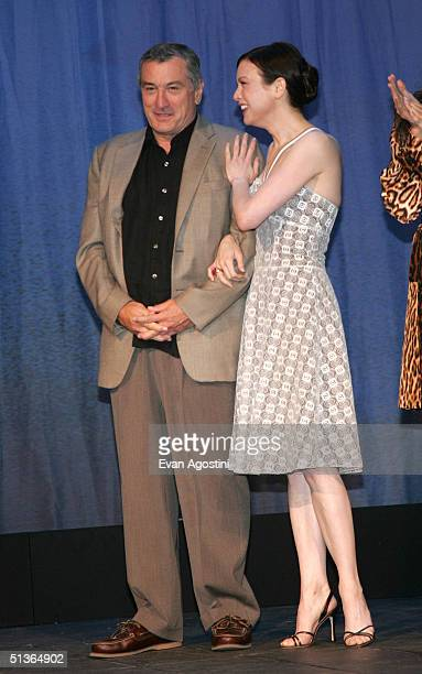 Actors Robert De Niro and Renee Zellweger appear on stage at the 'Shark Tale' premiere at Central Park's Delacorte Theater on September 27 2004 in...