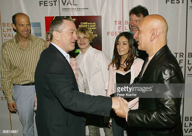 Actors Robert De Niro and Sir Ben Kingsley shake hands as Anthony Edwards Brady Corbet Vanessa Anne Hudgens and Jonathan Frakes look on as they...