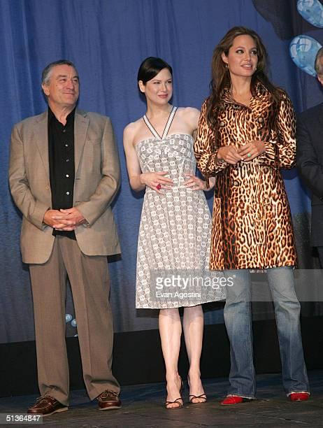 Actors Robert De Niro Renee Zellweger and Angelina Jolie attend the 'Shark Tale' premiere at Central Park's Delacorte Theater on September 27 2004 in...