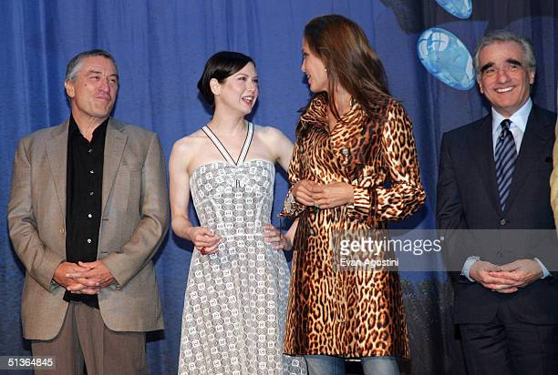 Actors Robert De Niro Renee Zellweger Angelina Jolie and director Martin Scorsese attend the 'Shark Tale' premiere at Central Park's Delacorte...