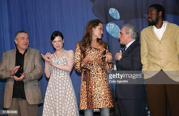 Actors Robert De Niro Renee Zellweger Angelina Jolie director Martin Scorsese and actor Doug E Doug attend the 'Shark Tale' premiere at Central...