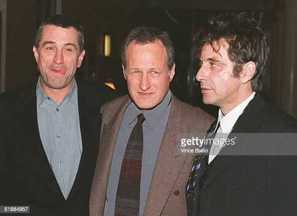 US actors Robert DeNiro and Al Pacino pose with director Michael Mann as they arrive for the 06 December world premiere of the film 'Heat' in Burbank...