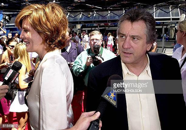 US actors Robert DeNiro and Rene Russo are interviewed as they arrive at the premiere of their new film 'The Adventures of Rocky and Bullwinkle' at...
