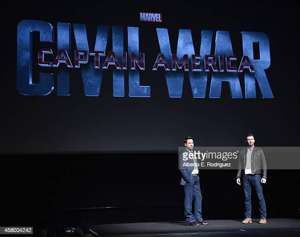 Actors Robert Downey Jr and Chris Evans onstage during Marvel Studios fan event at The El Capitan Theatre on October 28 2014 in Los Angeles California