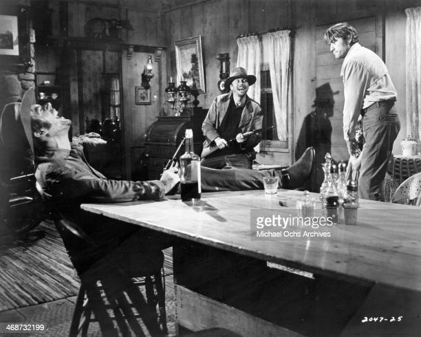 Actors Robert F Lyons John Davis Chandler and Gregory Peck on set of the movie 'Shoot Out' circa 1971
