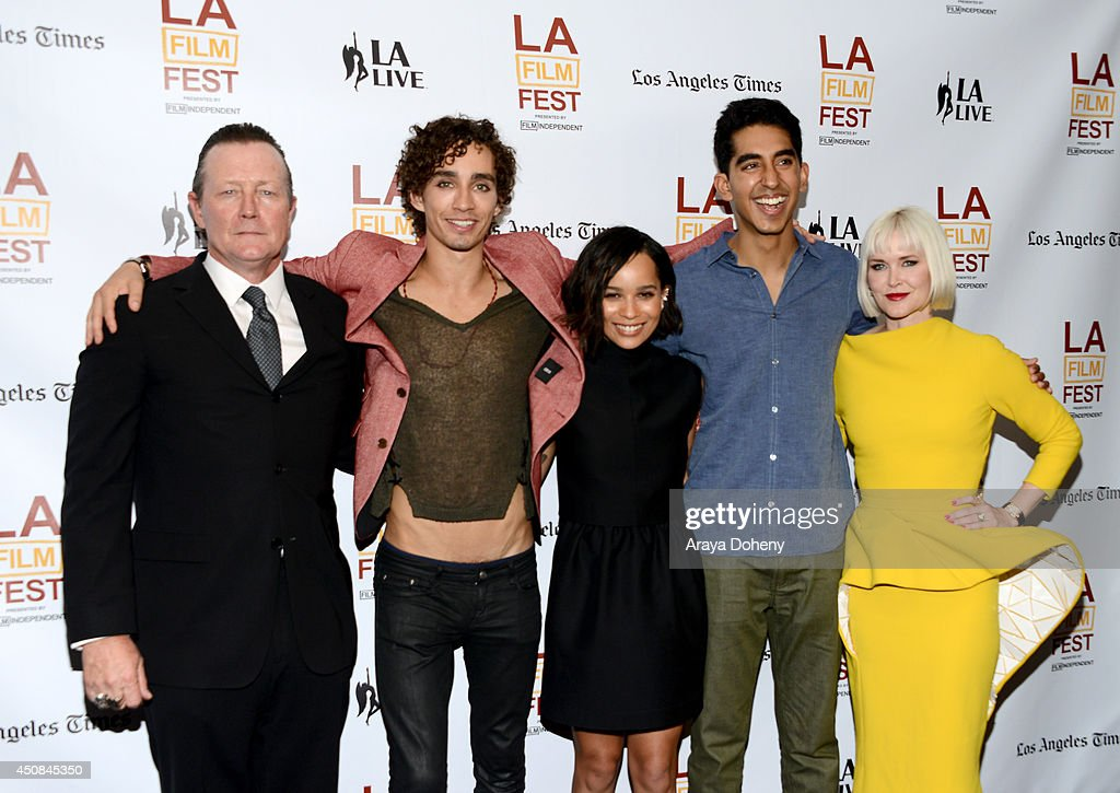 Actors <a gi-track='captionPersonalityLinkClicked' href=/galleries/search?phrase=Robert+Patrick&family=editorial&specificpeople=243027 ng-click='$event.stopPropagation()'>Robert Patrick</a>, Robert Sheehan, <a gi-track='captionPersonalityLinkClicked' href=/galleries/search?phrase=Zoe+Kravitz&family=editorial&specificpeople=680250 ng-click='$event.stopPropagation()'>Zoe Kravitz</a> and <a gi-track='captionPersonalityLinkClicked' href=/galleries/search?phrase=Dev+Patel&family=editorial&specificpeople=5123545 ng-click='$event.stopPropagation()'>Dev Patel</a> and writer/director Gren Wells, wearing a Jaeger-LeCoultre watch attend the premiere of 'The Road Within' during the 2014 Los Angeles Film Festival at Regal Cinemas L.A. Live on June 18, 2014 in Los Angeles, California.