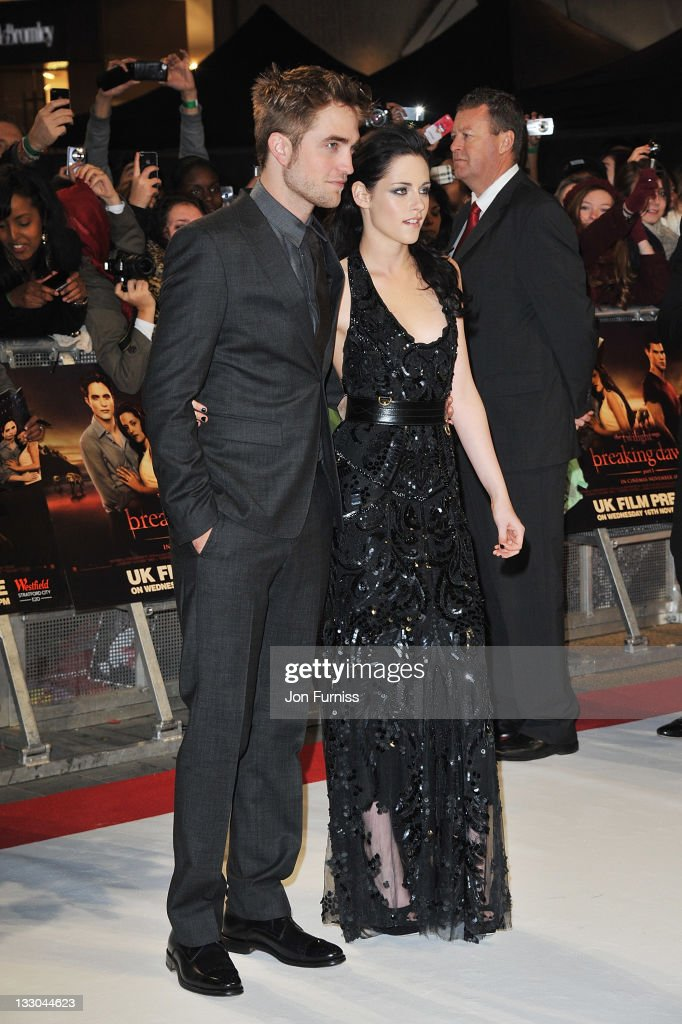Actors (L-R) <a gi-track='captionPersonalityLinkClicked' href=/galleries/search?phrase=Robert+Pattinson&family=editorial&specificpeople=734445 ng-click='$event.stopPropagation()'>Robert Pattinson</a> and <a gi-track='captionPersonalityLinkClicked' href=/galleries/search?phrase=Kristen+Stewart&family=editorial&specificpeople=2166264 ng-click='$event.stopPropagation()'>Kristen Stewart</a> and Taylor Lautner attend 'The Twilight Saga: Breaking Dawn Part 1' UK Premiere, at Westfield Stratford City on November 16, 2011 in London, England.
