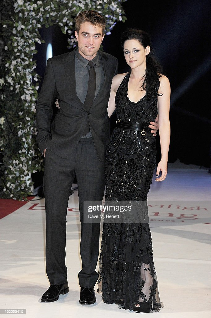 Actors <a gi-track='captionPersonalityLinkClicked' href=/galleries/search?phrase=Robert+Pattinson&family=editorial&specificpeople=734445 ng-click='$event.stopPropagation()'>Robert Pattinson</a> (L) and <a gi-track='captionPersonalityLinkClicked' href=/galleries/search?phrase=Kristen+Stewart&family=editorial&specificpeople=2166264 ng-click='$event.stopPropagation()'>Kristen Stewart</a> attend the UK Premiere of 'The Twilight Saga: Breaking Dawn Part 1' at Westfield Stratford City on November 16, 2011 in London, England.