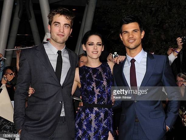 Actors Robert Pattinson Kristen Stewart and Taylor Lautner arrive at the premiere of Summit Entertainment's 'The Twilight Saga Breaking Dawn Part 1'...