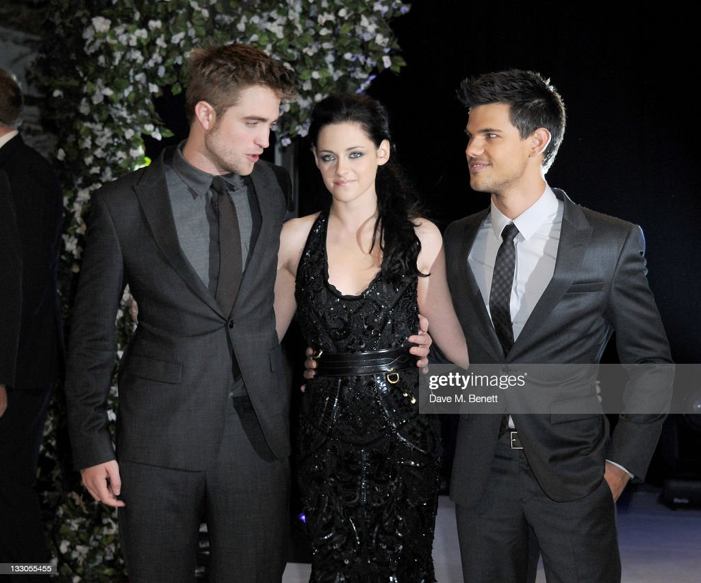 Actors <a gi-track='captionPersonalityLinkClicked' href=/galleries/search?phrase=Robert+Pattinson&family=editorial&specificpeople=734445 ng-click='$event.stopPropagation()'>Robert Pattinson</a>, <a gi-track='captionPersonalityLinkClicked' href=/galleries/search?phrase=Kristen+Stewart&family=editorial&specificpeople=2166264 ng-click='$event.stopPropagation()'>Kristen Stewart</a> and <a gi-track='captionPersonalityLinkClicked' href=/galleries/search?phrase=Taylor+Lautner&family=editorial&specificpeople=228959 ng-click='$event.stopPropagation()'>Taylor Lautner</a> attend the UK Premiere of 'The Twilight Saga: Breaking Dawn Part 1' at Westfield Stratford City on November 16, 2011 in London, England.