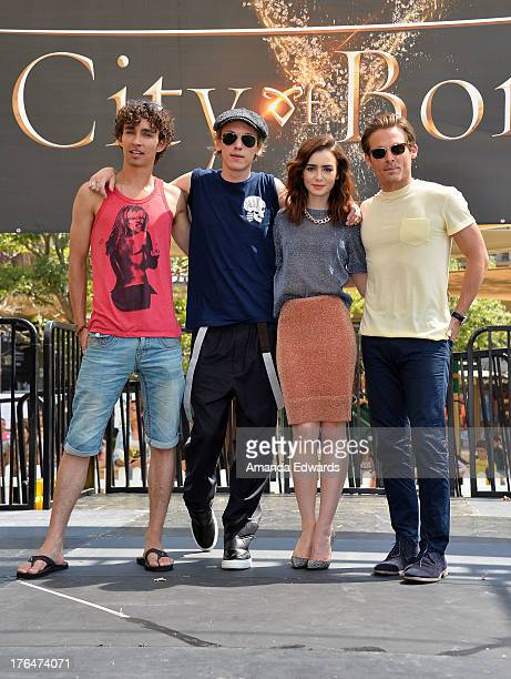 Actors Robert Sheehan Jamie Campbell Bower Lily Collins and Kevin Zegers attend 'The Mortal Instruments City Of Bones' meet and greet at The...