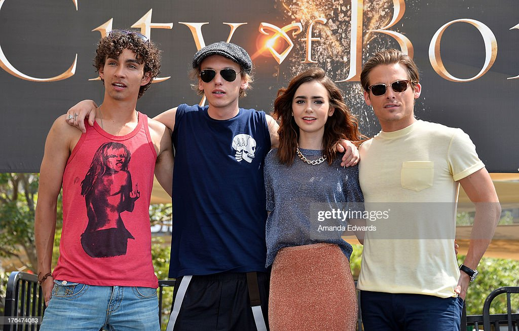 Actors Robert Sheehan, <a gi-track='captionPersonalityLinkClicked' href=/galleries/search?phrase=Jamie+Campbell+Bower&family=editorial&specificpeople=4586724 ng-click='$event.stopPropagation()'>Jamie Campbell Bower</a>, <a gi-track='captionPersonalityLinkClicked' href=/galleries/search?phrase=Lily+Collins&family=editorial&specificpeople=3520243 ng-click='$event.stopPropagation()'>Lily Collins</a> and <a gi-track='captionPersonalityLinkClicked' href=/galleries/search?phrase=Kevin+Zegers&family=editorial&specificpeople=622283 ng-click='$event.stopPropagation()'>Kevin Zegers</a> attend 'The Mortal Instruments: City Of Bones' meet and greet at The Americana at Brand on August 13, 2013 in Glendale, California.