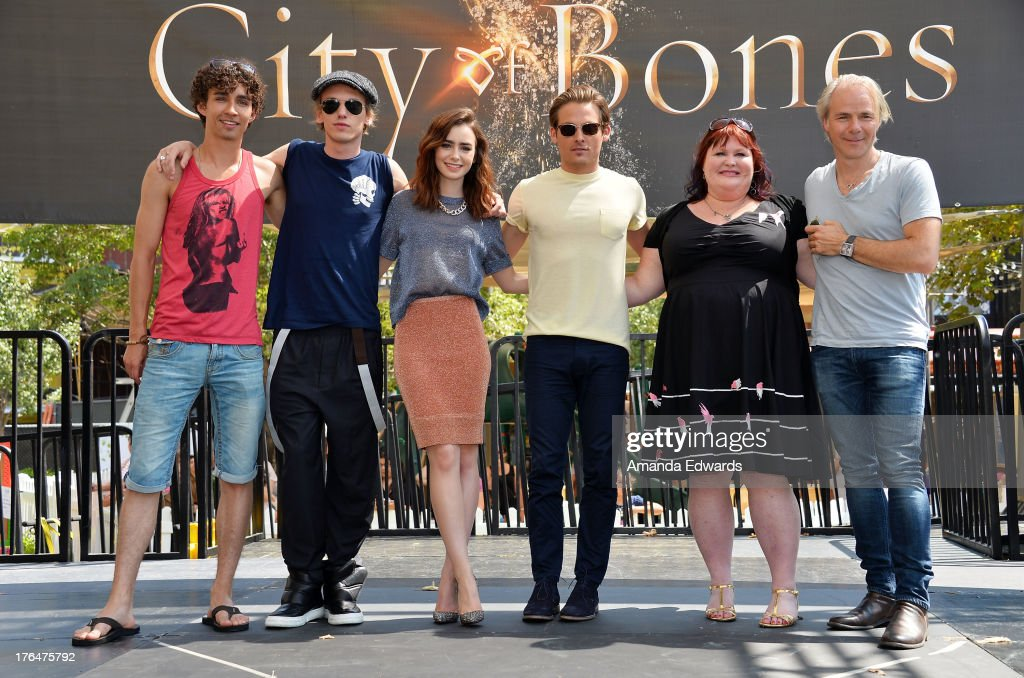 Actors Robert Sheehan, <a gi-track='captionPersonalityLinkClicked' href=/galleries/search?phrase=Jamie+Campbell+Bower&family=editorial&specificpeople=4586724 ng-click='$event.stopPropagation()'>Jamie Campbell Bower</a>, <a gi-track='captionPersonalityLinkClicked' href=/galleries/search?phrase=Lily+Collins&family=editorial&specificpeople=3520243 ng-click='$event.stopPropagation()'>Lily Collins</a> and <a gi-track='captionPersonalityLinkClicked' href=/galleries/search?phrase=Kevin+Zegers&family=editorial&specificpeople=622283 ng-click='$event.stopPropagation()'>Kevin Zegers</a>, novelist Cassandra Clare and director <a gi-track='captionPersonalityLinkClicked' href=/galleries/search?phrase=Harald+Zwart&family=editorial&specificpeople=3742869 ng-click='$event.stopPropagation()'>Harald Zwart</a> attend 'The Mortal Instruments: City Of Bones' meet and greet at The Americana at Brand on August 13, 2013 in Glendale, California.