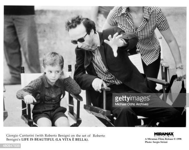 Actors Roberto Benigni and Giorgio Cantarini on the set of the Miramax movie 'Life Is Beautiful' circa 1997
