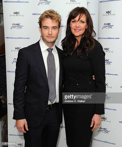 Actors Robin Dunne and Amanda Tapping pose for photos before greeting fans at the NBC Experience Store on October 7 2011 in New York City