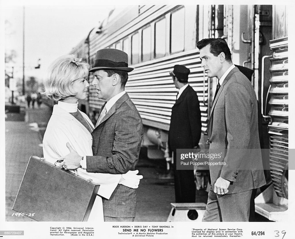 Actors <a gi-track='captionPersonalityLinkClicked' href=/galleries/search?phrase=Rock+Hudson&family=editorial&specificpeople=94007 ng-click='$event.stopPropagation()'>Rock Hudson</a> (right), <a gi-track='captionPersonalityLinkClicked' href=/galleries/search?phrase=Tony+Randall+-+Actor&family=editorial&specificpeople=167042 ng-click='$event.stopPropagation()'>Tony Randall</a> and <a gi-track='captionPersonalityLinkClicked' href=/galleries/search?phrase=Doris+Day&family=editorial&specificpeople=207120 ng-click='$event.stopPropagation()'>Doris Day</a> in a scene from the film 'Send Me No Flowers', 1964.