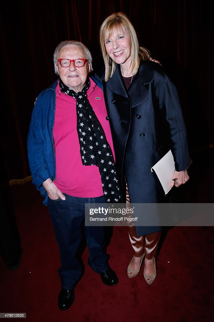 Actors Roger Dumas and Chantal Ladesou pose after the 'Open Space' : Theater Play at Theatre de Paris on May 11, 2015 in Paris, France.