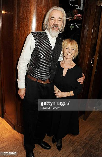 Actors Roger Lloyd Pack working as a waiter and Sheila Reid working as a cloakroom attendant attend One Night Only at The Ivy featuring 30 stage and...