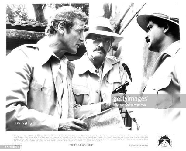 Actors Roger Moore and Gregory Peck on set of the Paramount Pictures movie 'The Sea Wolves' 1980