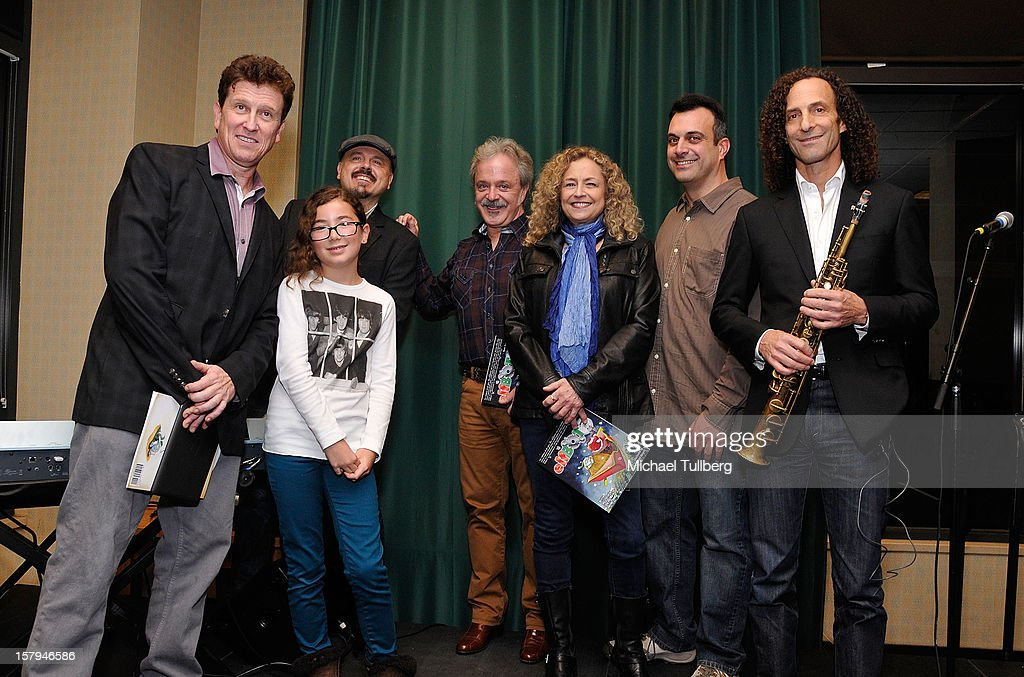 Actors Roger Rhodes and Haden Ryan-Embry, musician Walter Afanasieff, actors Jim Cummings, Jeannie Elias and Greg Bogosian and musician <a gi-track='captionPersonalityLinkClicked' href=/galleries/search?phrase=Kenny+G&family=editorial&specificpeople=211357 ng-click='$event.stopPropagation()'>Kenny G</a> attend a reading of the new Christmas children's book 'ELFBOT' at The Americana at Brand on December 7, 2012 in Glendale, California.