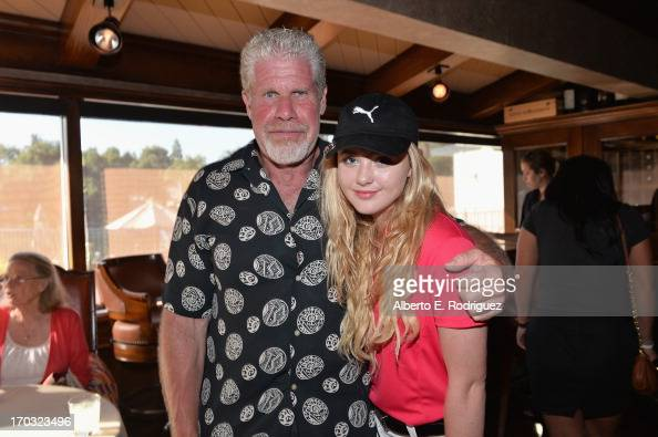 Actors Ron Perlman and Kathryn Newton attend the Screen Actors Guild Foundation 4th Annual Los Angeles Golf Classic at Lakeside Golf Club on June 10...
