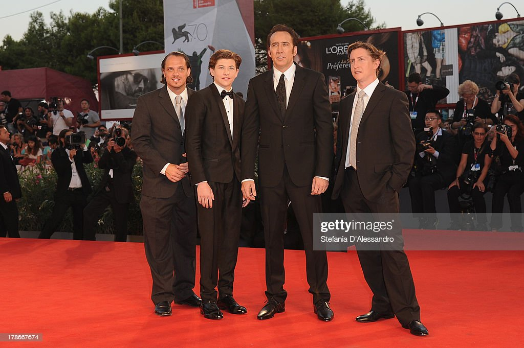 Actors Ronie Gene Blevins, <a gi-track='captionPersonalityLinkClicked' href=/galleries/search?phrase=Tye+Sheridan&family=editorial&specificpeople=7807719 ng-click='$event.stopPropagation()'>Tye Sheridan</a>, <a gi-track='captionPersonalityLinkClicked' href=/galleries/search?phrase=Nicolas+Cage&family=editorial&specificpeople=196531 ng-click='$event.stopPropagation()'>Nicolas Cage</a> and Director <a gi-track='captionPersonalityLinkClicked' href=/galleries/search?phrase=David+Gordon+Green&family=editorial&specificpeople=2901053 ng-click='$event.stopPropagation()'>David Gordon Green</a> attend 'Joe' Premiere during The 70th Venice International Film Festival at Sala Grande on August 30, 2013 in Venice, Italy.