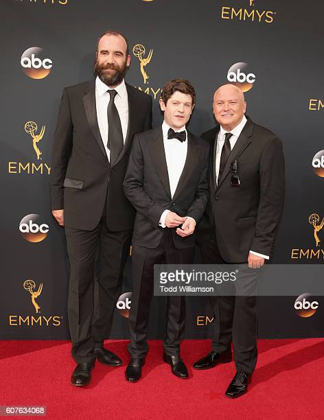 Actors Rory McCann Iwan Rheon and Conleth Hill attend the 68th Annual Primetime Emmy Awards at Microsoft Theater on September 18 2016 in Los Angeles...