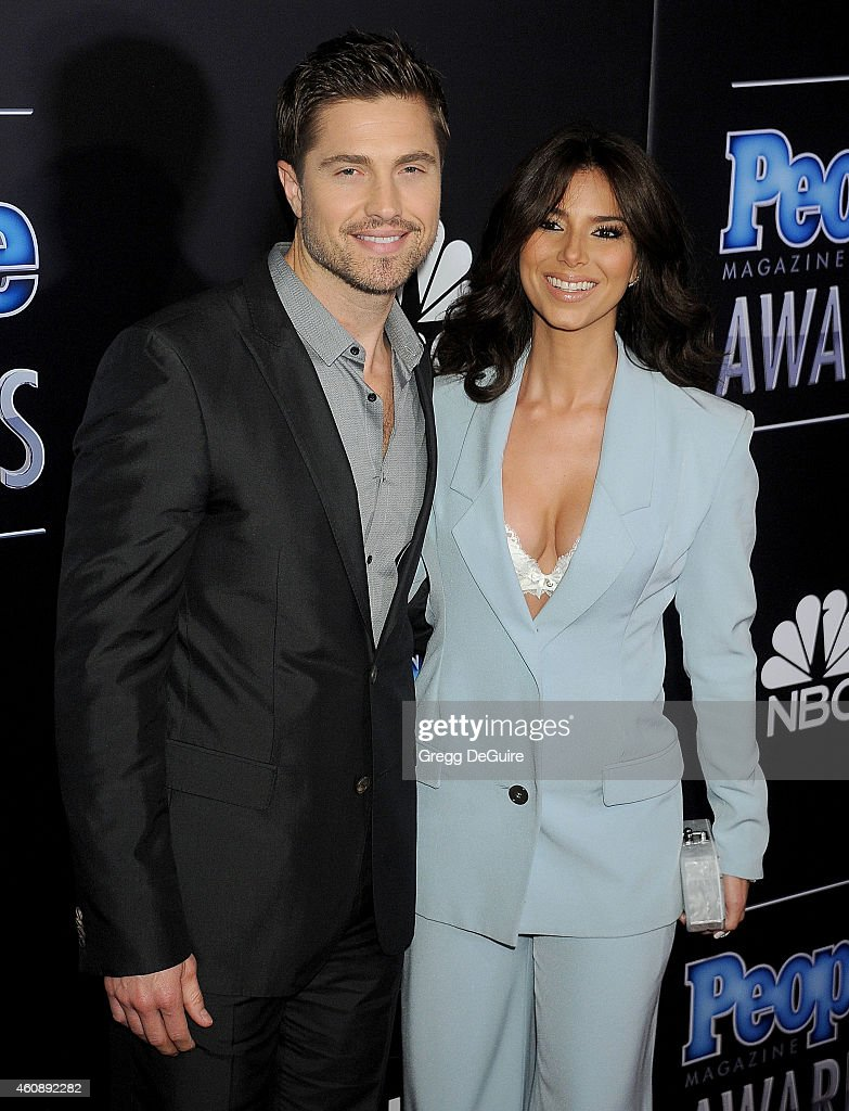 Actors Roselyn Sanchez and Eric Winter arrive at The PEOPLE Magazine Awards at The Beverly Hilton Hotel on December 18, 2014 in Beverly Hills, California.