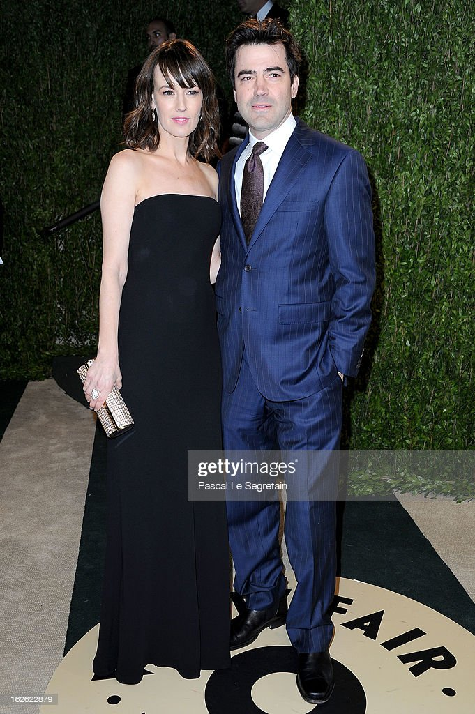 Actors Rosemarie DeWitt (L) and Ron Livingston arrive at the 2013 Vanity Fair Oscar Party hosted by Graydon Carter at Sunset Tower on February 24, 2013 in West Hollywood, California.
