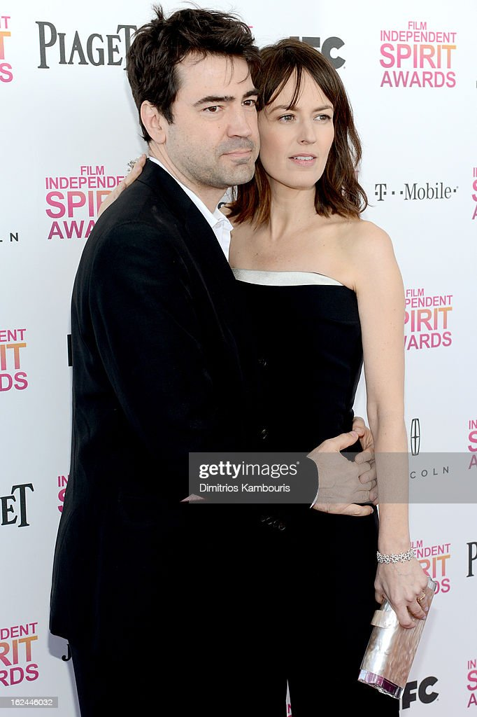 Actors Rosemarie DeWitt (R) and Ron Livingston arrive with Jameson prior to the 2013 Film Independent Spirit Awards at Santa Monica Beach on February 23, 2013 in Santa Monica, California.