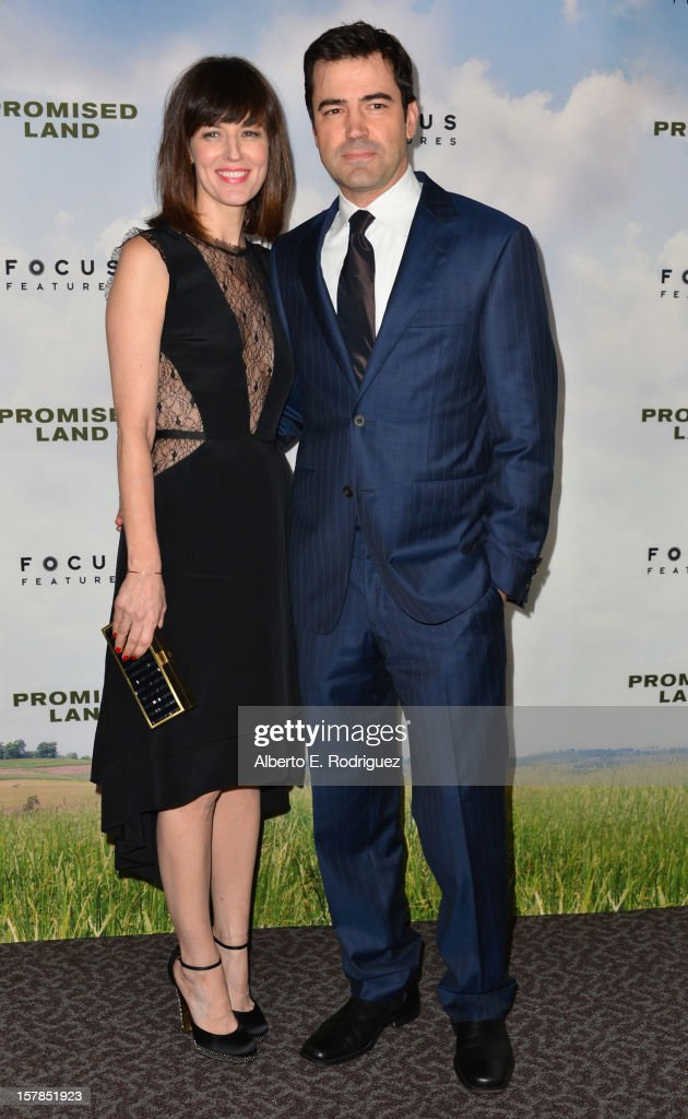 Actors Rosemarie DeWitt and Ron Livivngston arrive to the premiere of Focus Features' 'Promised Land' at the Directors Guild Of America on December 6, 2012 in Los Angeles, California.