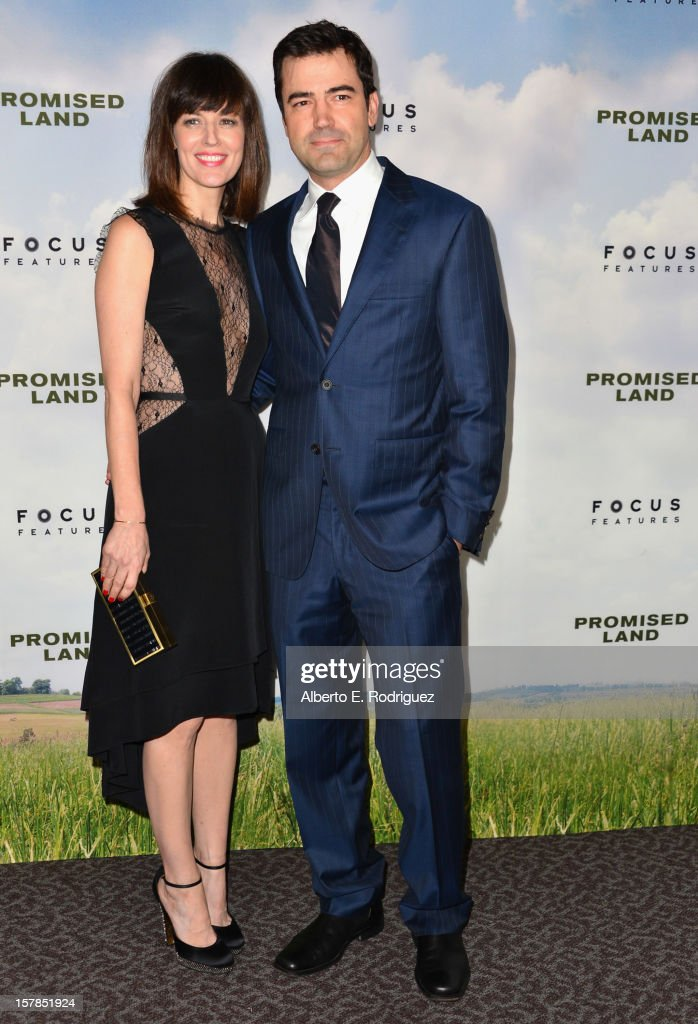 Actors <a gi-track='captionPersonalityLinkClicked' href=/galleries/search?phrase=Rosemarie+DeWitt&family=editorial&specificpeople=630212 ng-click='$event.stopPropagation()'>Rosemarie DeWitt</a> and Ron Livivngston arrive to the premiere of Focus Features' 'Promised Land' at the Directors Guild Of America on December 6, 2012 in Los Angeles, California.
