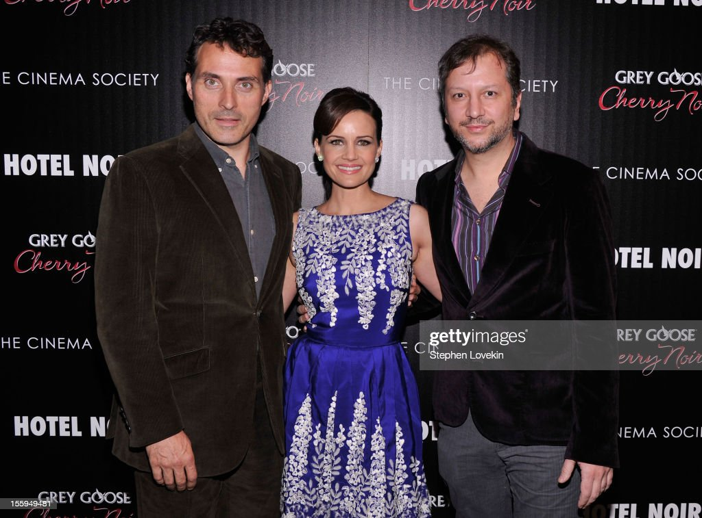 Actors <a gi-track='captionPersonalityLinkClicked' href=/galleries/search?phrase=Rufus+Sewell&family=editorial&specificpeople=558279 ng-click='$event.stopPropagation()'>Rufus Sewell</a>, <a gi-track='captionPersonalityLinkClicked' href=/galleries/search?phrase=Carla+Gugino&family=editorial&specificpeople=207137 ng-click='$event.stopPropagation()'>Carla Gugino</a> and director Sebastian Gutierrez attend the Gato Negro Films And The Cinema Society Host A Screening Of 'Hotel Noir' at Crosby Street Hotel on November 9, 2012 in New York City.